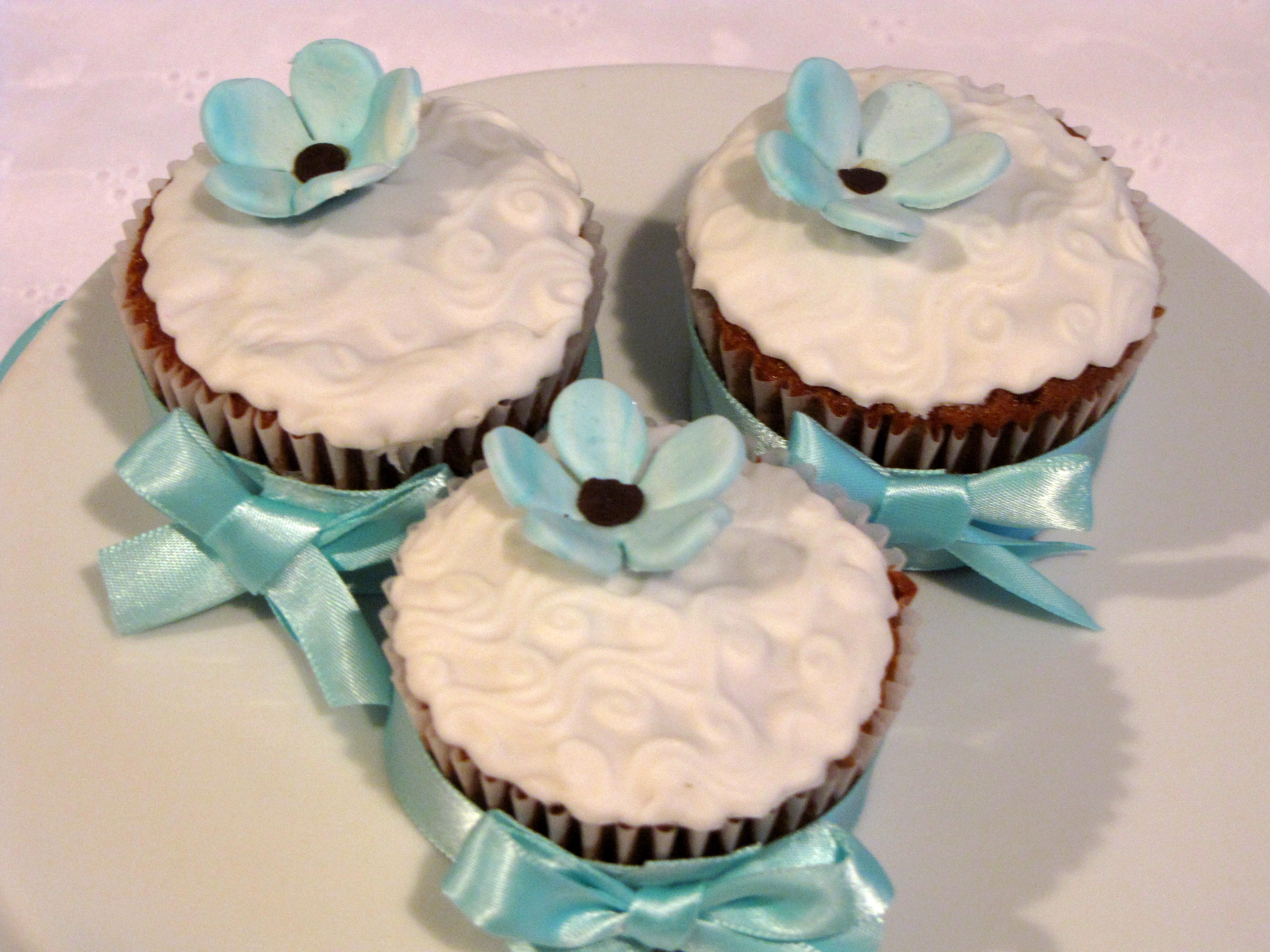 Here are some fondant covered carrot cupcakes topped with a